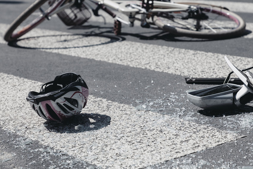 bicycle and helmet on ground after accident