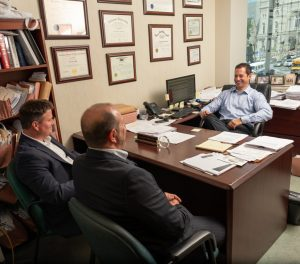 Spear Greenfield Attorneys Jeremy, Scott and Marc in meeting in offices