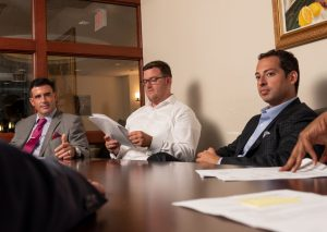 Spear Greenfield attorneys in office in meeting