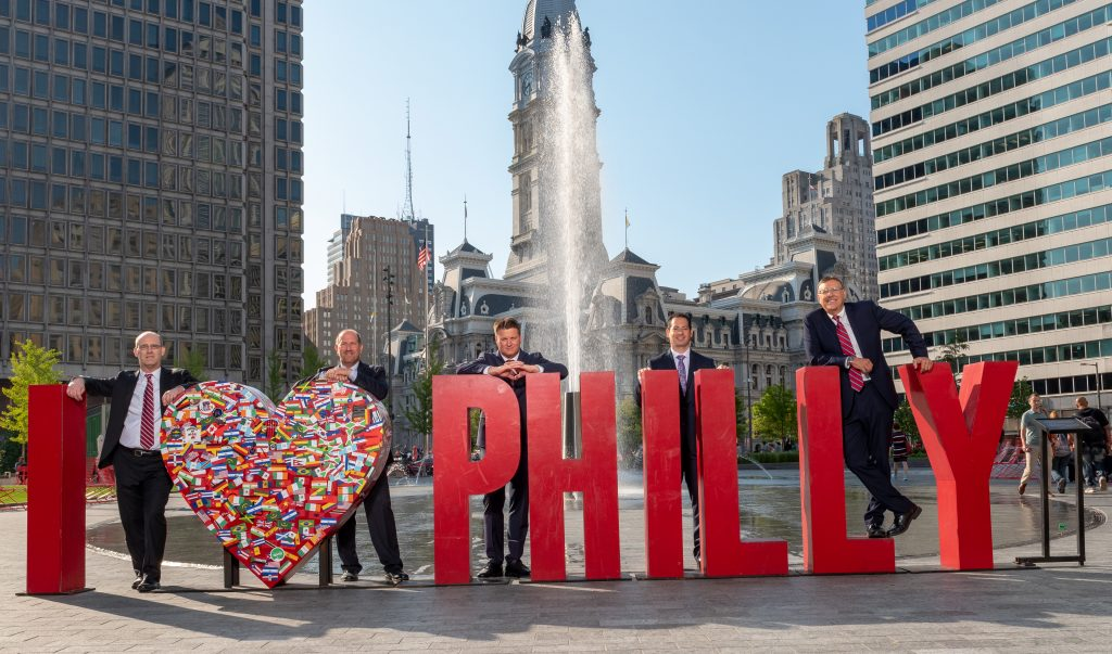 Spear Greenfield attorneys posing with I Love Philly sign in downtown Philadelphia